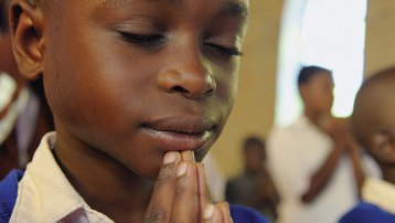 Uganda-child-praying-closeup